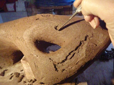 At the point where the form is complete apart from finishing the surface stop building and get ready to hollow -out. The piece should be firm enough to resist a thumb-print. On very large pieces you might start hollowing the top while the lower parts are still too damp; the hollowed clay walls will need to be able to support themselves with-out distorting. Don't let the form get to hard or you wont be able to cut it open.