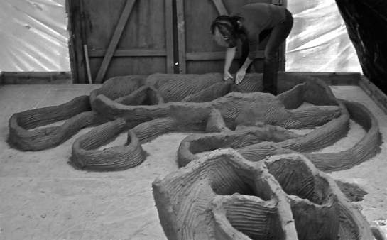 Here I am putting down the first layers of 2 big sculptures. I am using Coleford brick clay in a very soft state. My 'coils' are half bag blocks but they are applied and treated in the same way as any good coil. The walls are thicker at the base to support the considerable weight of the next layers. The internal support-walls are thinner. On very big sculptures these support walls will be discarded when the sculpture is cut into sections. On medium sized sculptures, that will be cut into parts not panels, the internal support walls will be left in to maintain the shapes during firing.