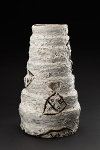 Kirk Mangus  3 Flying Houses Ziggurat  , 1982 Stoneware, white tapies glaze (inspired by Antoni Tapies) 12.5 x 7 x 7 inches 31.8 x 17.8 x 17.8 cm KMg 1