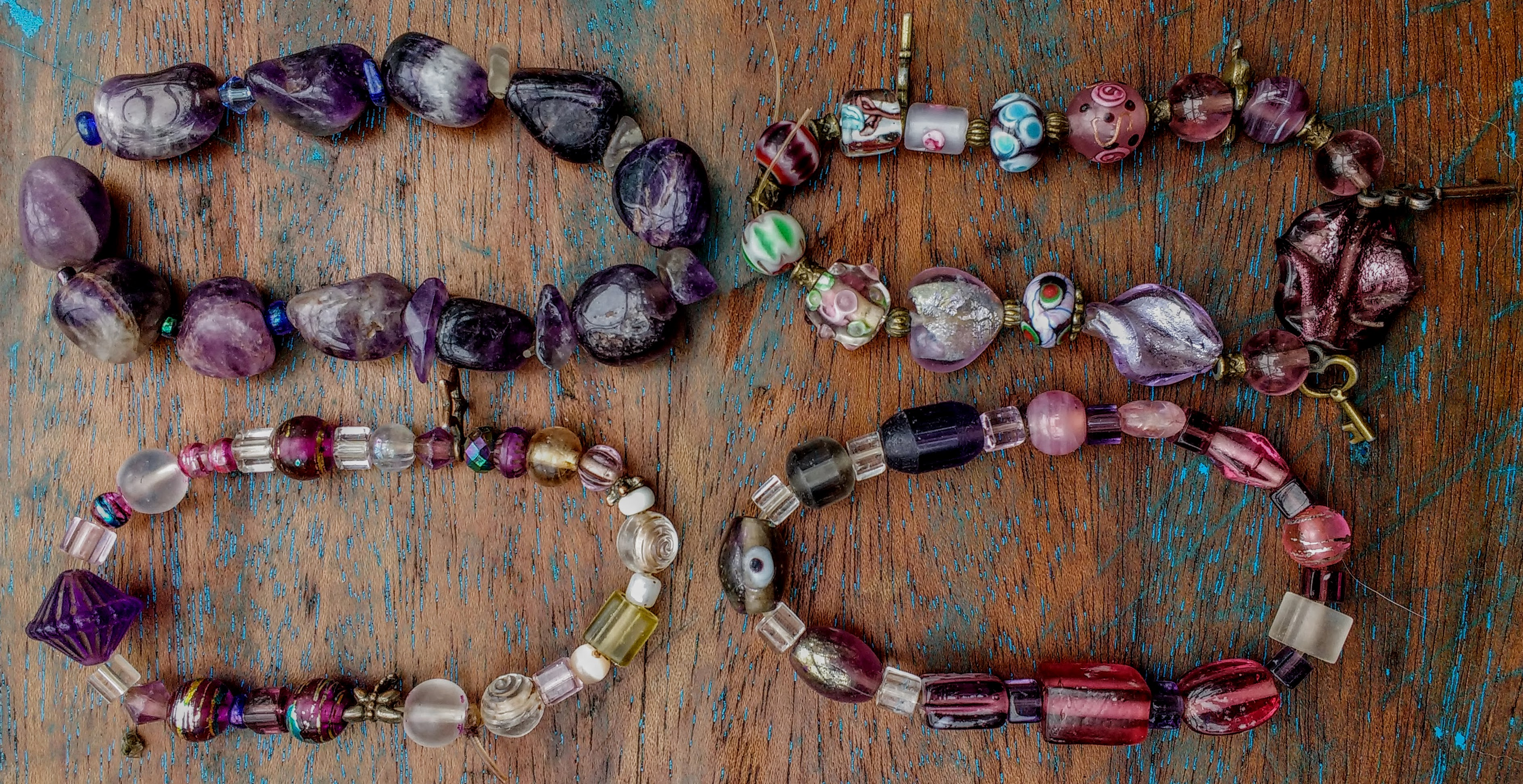 Shades of purple glass and stones with a few acrylic beads and charms. Sold.